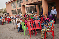 Syrians from Kobane/Ayn al-Arab living in a temporary shelter and food distribution centre operated by the Diyarbakir city council in Suruç, southern Turkey.