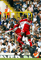 Photo: Chris Ratcliffe, Digitalsport<br /> Tottenham Hotspur v Middlesbrough. The Barclays Premiership. 20/08/2005.<br /> Anthony Gradner of Spurs clears the ball under pressure from Aiyegbeni Yakubu and Jimmy Floyd Hasselbaink of Boro<br /> Norway only