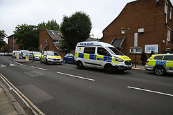 © Licensed to London News Pictures. 04/07/2020. London, UK. Police van and cars near Roman Way, Islington in north London as police launch a murder investigation following fatal shooting. Police were called at at 3.20pm to Roman Way, following reports of shots fired.  Officers attended with LAS and found a man, believed to be aged in his early 20s, suffering from gunshot injuries. Despite their best efforts, he was pronounced dead at the scene. Photo credit: Dinendra Haria/LNP