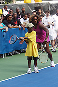 l to r: Isaiah Dillard and Serena Williams at the Nike Youth Tennis  Challenge held at The Nike -Built regulation Tennis Court  on West 23rd Street & Broadway in New York  City . ..Hundreds of tennis fans and youth form New York  Parks and Rec. Athlethes for Charity, and Mentoring USA are treating to tips and guidance from Tennis Pros Roger Federer, Rafael Nadal and Serena Williams...