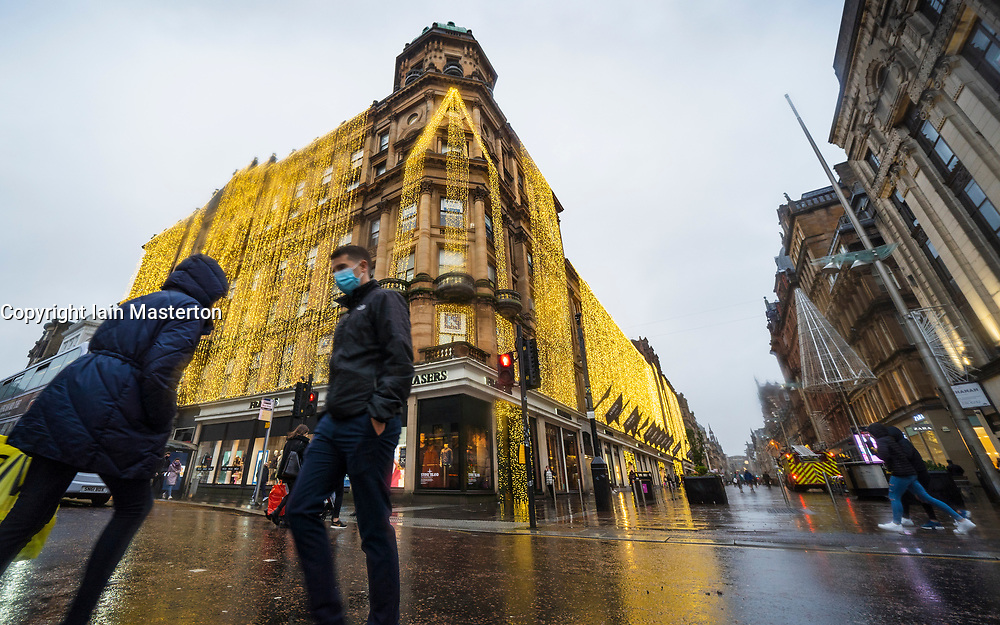 Evening view of Frasers department store with Christmas lights on Buchanan Street during rain , Glasgow, Scotland ,UK