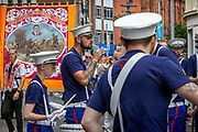 Thousands of Orange Order members took to the streets  to mark the main date in the Protestant loyal order parading season. Due to Covid restriction, this year's Twelfth of July parades were smaller than usual and more locally based.<br /> <br /> Orange March, Belfast, NI,2021