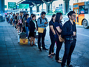 25 SEPTEMBER 2017 - RANGSIT, PATHUM THANI, THAILAND: People in line to board minivans at a vanstop near Future Park Mall in Rangsit.       PHOTO BY JACK KURTZ