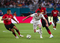 July 31, 2018 - Miami Gardens, Florida, USA - Real Madrid C.F. midfielder Federico Valverde (37) (center) drives the ball past Manchester United F.C. defender Eric Bailly (3) (behind), and pressured by forward Alexis Sanchez (7) (left), during an International Champions Cup match between Real Madrid C.F. and Manchester United F.C. at the Hard Rock Stadium in Miami Gardens, Florida. Manchester United F.C. won the game 2-1. (Credit Image: © Mario Houben via ZUMA Wire)