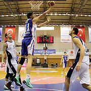 Anadolu Efes's Emircan Kosut (2ndL) during their Turkish Basketball League match Istanbul BSB between Anadolu Efes at Cebeci Arena in Istanbul Turkey on Monday 09 March 2015. Photo by Aykut AKICI/TURKPIX
