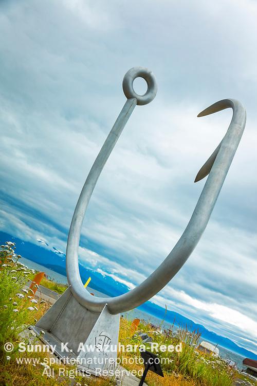 Circle Hook Sculpture at Homer Boat Harbor, Homer Spit, Homer, Kenai Peninsula, Southcentral Alaska, Summer. Vertical image.