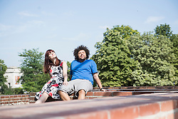 Relaxed young couple sitting outdoors