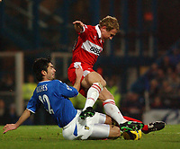 Fotball<br /> England 2004/2005<br /> Foto: BPI/Digitalsport<br /> NORWAY ONLY<br /> <br /> Portsmouth v Middlesborough 1/2/2005.<br /> Barclays Premiership.<br /> Portsmouth's Richard Hughes tackles and Boro's Ray Parlour