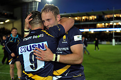 Chris Pennell of Worcester Warriors embraces team-mate JB Bruzelier - Photo mandatory by-line: Patrick Khachfe/JMP - Mobile: 07966 386802 27/05/2015 - SPORT - RUGBY UNION - Worcester - Sixways Stadium - Worcester Warriors v Bristol Rugby - Greene King IPA Championship Play-off Final (Second leg)