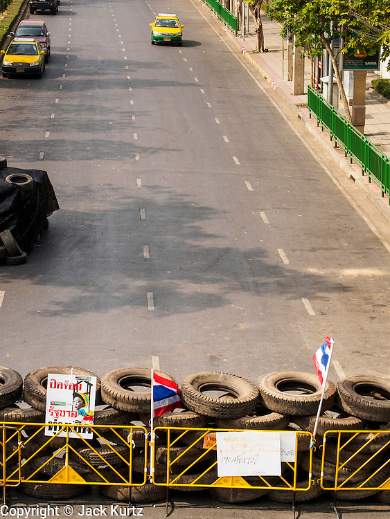 "30 DECEMBER 2013 - BANGKOK, THAILAND:  Anti-government protestors have put a roadblock across Phitsanulok Road near Government House in Bangkok. Violence around the anti-government protest sites has escalated in recent days and several protestors have been hurt by small explosive devices thrown at their guard posts. As a result, protestors are fortifying their positions with sandbags and bunkers. Suthep Thaugsuban, the leader of the anti-government protests in Bangkok, has called for a new series of massive protests after the 1st of the year and said it the shutdown, or what he described was the seizure of the capital, would be the day when ""People's Revolution"" would ""begin to end and uproot the Thaksin regime.""         PHOTO BY JACK KURTZ"
