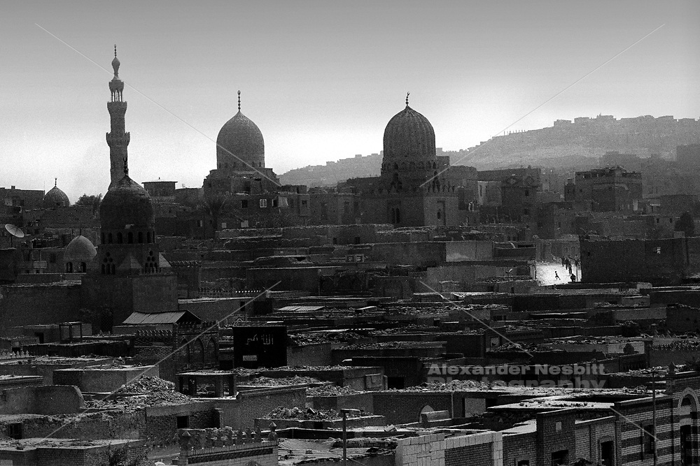 Cairo, Egypt, The City of the Dead  1999 - Some 1/2 million people inhabit the massive, 7km long cemetery that borders the easter side of Cairo.  They form a complete civilization living on top of, within, and around the graves of their ancestors.