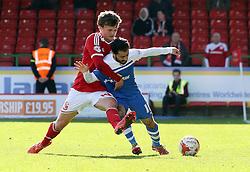 Peterborough United's Erhun Oztumer battles with Swindon Town's John Swift - Photo mandatory by-line: Joe Dent/JMP - Mobile: 07966 386802 - 11/04/2015 - SPORT - Football - Swindon - County Ground - Swindon Town v Peterborough United - Sky Bet League One