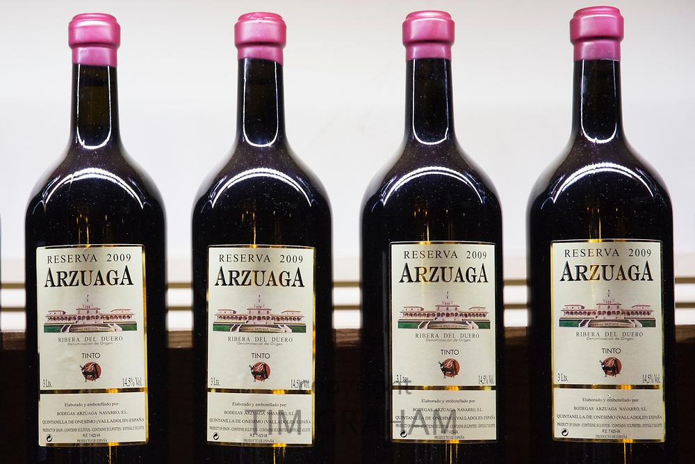 Bottles of red wine of Bodegas Arzuaga Reserva 2009, ribera del Duero wine production by River Duero, Navarro, Spain