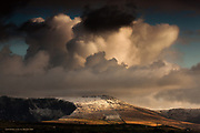 Second snows on the Welsh hills, and a dusted icing across the rounded lower peaks of the Nantlle area - as seen from Anglesey.