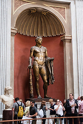 Vatican City Museum The bronze gilded cult statue of Hercules of the Theatre of Pompey in the Sala Rotonda , Rome, Italy