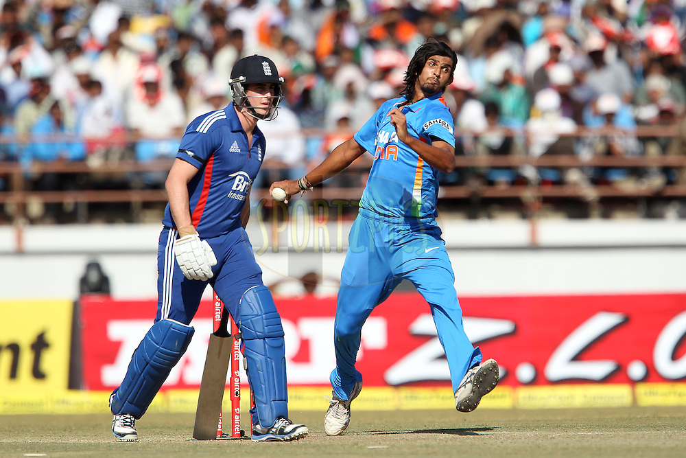 Ishant Sharma of India bowls as Craig Kieswetter of England looks on during the 1st Airtel ODI Match between India and England held at the SAURASHTRA CRICKET ASSOCIATION STADIUM, RAJKOT, India on the 11th January 2013..Photo by Ron Gaunt/BCCI/SPORTZPICS ..Use of this image is subject to the terms and conditions as outlined by the BCCI. These terms can be found by following this link:..http://www.sportzpics.co.za/image/I0000SoRagM2cIEc