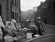 Some housing in Dublin was very old and dilapidated and there were several collapses. This lady and her belongings await rehousing.