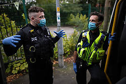 © Licensed to London News Pictures . 11/09/2020. Bolton , UK . PCs TERRY WILKINSON and TONY LOWE during the patrol . Police officers from Greater Manchester Police and Environmental Health Officers from Bolton Council respond to concerns of breaches of Coronavirus regulations , as stricter lockdown measures and a curfew on hospitality businesses are imposed in the borough to limit the spread of Covid-19 . Photo credit : Joel Goodman/LNP