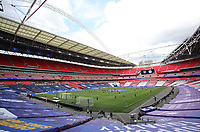 Football - 2020 Emirates 'Heads Up' FA Cup Final - Arsenal vs. Chelsea <br /> <br /> A wide view of the ground with the empty stands as both teams warm-up, at Wembley Stadium.<br /> <br /> The match is being played behind closed doors because of the current COVID-19 Coronavirus pandemic, and government social distancing/lockdown restrictions.