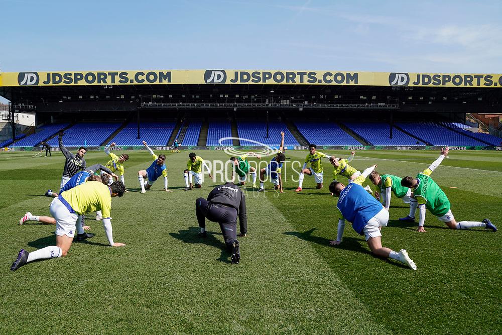 Leeds United U23 warm up during the U23 Professional Development League match between U23 Crystal Palace and Leeds United at Selhurst Park, London, England on 15 April 2019.