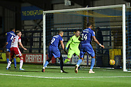 AFC Wimbledon defender Terell Thomas (6) scoring goal to make it 3-0 during the EFL Trophy group stage match between AFC Wimbledon and Stevenage at the Cherry Red Records Stadium, Kingston, England on 6 November 2018.