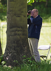 © London News Pictures. 12/05/2012. Windsor, UK. HRH Prince Philip  using binoculars while time keeping at The Land Rover International Driving competition on day four of the Royal Windsor Horse Show in the grounds of Windsor Castle, Berkshire,  on May 12, 2012. Photo credit: Ben Cawthra/LNP