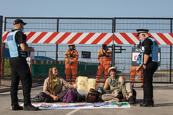 Environmental activists from HS2 Rebellion use a lock-on arm tube to block a gate to the South Portal site for the HS2 high-speed rail link on 14 September 2020 in West Hyde, United Kingdom. Anti-HS2 activists blocked two gates to the same works site for the controversial £106bn rail link, one remaining closed for over six hours and another for over nineteen hours.