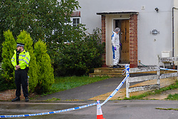 © Licensed to London News Pictures. 18/10/2021. Oxford, UK. A forensic investigator stands in the doorway to a property on Pinnocks Way, Botley in Oxfordshire following a fatal stabbing. Thames Valley Police were called to the property at approximately 21:05 BST on Sunday 17/10/2021. A man in his thirties died at the scene. A 33-year-old man from Oxfordshire has been arrested on suspicion of murder. Photo credit: Peter Manning/LNP