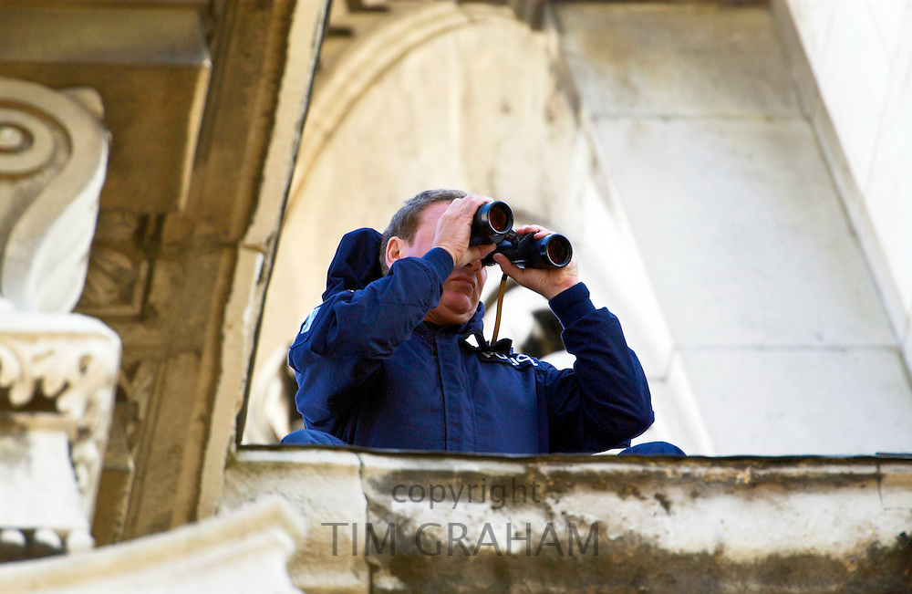 Armed security checking the crowds through binoculars during a special Service of Remembrance and Commemoration at St Paul's Cathedral today which was held in honour of those who died in the terrorist attacks that struck New York, Washington and Pennsylvania on September 11th 2001.