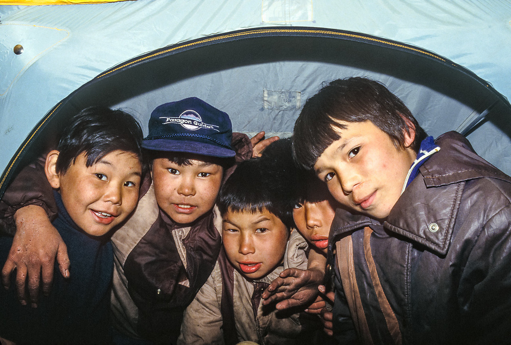 How many native boys can fit in a photographer's tent? Village of Uelen, Chukotsk Peninsula, Northeast Russia, 1992