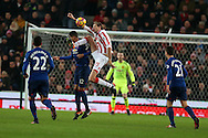 Peter Crouch of Stoke city controls the ball ahead of Chris Smalling of Manchester Utd.  Premier league match, Stoke City v Manchester Utd at the Bet365 Stadium in Stoke on Trent, Staffs on Saturday 21st January 2017.<br /> pic by Andrew Orchard, Andrew Orchard sports photography.