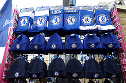 Chelsea hats and scarves for sale before the Premier League match at Stamford Bridge, London.