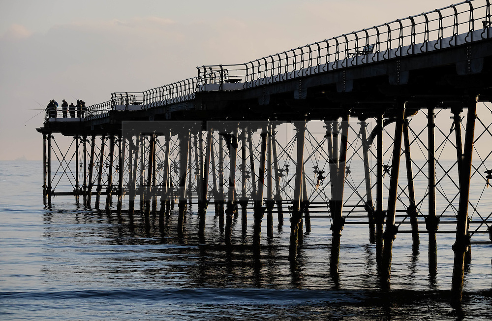 © Licensed to London News Pictures. <br /> 18/08/2016. <br /> Satburn-By-The-Sea, UK.  <br /> <br /> Fisherman stand on the end of the pier in soft morning light at daybreak in Saltburn-By-The-Sea.<br /> <br /> Photo credit: Ian Forsyth/LNP