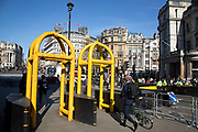 Yellow security barriers installed at Trafalgar Square in central London, England, United Kingdom. These temporary, movable barrier systems are placed strategically across the capital in the wake of terrorist threats in places where large numbers of people gather as a preventative measure.