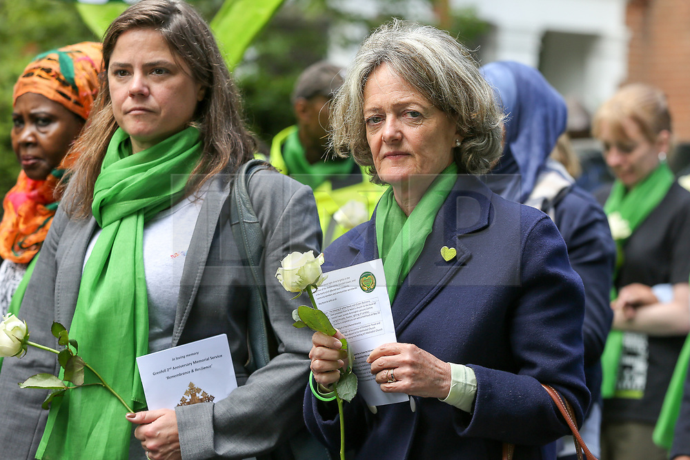 © Licensed to London News Pictures. 14/06/2019. London, UK. Kensington and Chelsea council leader, Elizabeth Campbell (R) wears a symbolic green scarf as she takes part in a silent procession marching from St Helen's Church to Grenfell Tower to commemorate the second anniversary of the Grenfell Tower fire. On 14 June 2017, just before 1:00am a fire broke out in the kitchen of the fourth floor flat at the 24-storey residential tower block in North Kensington, West London, which took the lives of 72 people. More than 70 others were injured and 223 people escaped. Photo credit: Dinendra Haria/LNP