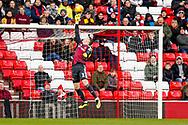 Sunderland goalkeeper Jon McLaughlin (1) tiips over a 40 yard strike from Wimbledon midfielder Anthony Wordsworth (40)  during the EFL Sky Bet League 1 match between Sunderland and AFC Wimbledon at the Stadium Of Light, Sunderland, England on 2 February 2019.