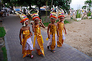 Young girls in traditional Balinese dancers' dress as part of Galungan ceremonies. Galungan celebrates the victory of virtue (Dharma) over evil (Adharma) and is perhaps the most important religious holiday for Balinese Hindus. Sanur, Bali, Indonesia