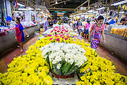 09 OCTOBER 2012 - BANGKOK, THAILAND: The main aisle in the Bangkok Flower Market. The Bangkok Flower Market (Pak Klong Talad) is the biggest wholesale and retail fresh flower market in Bangkok. The market is located in the old part of the city, south of Wat Po (Temple of the Reclining Buddha) and the Grand Palace.    PHOTO BY JACK KURTZ