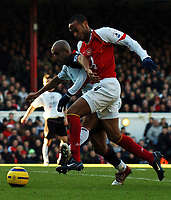 Photo: Javier Garcia/Back Page Images<br />Arsenal v Fulham, FA Barclays Premiership, Highbury, 26/12/04<br />Zesh Rehman struggles to contain a rampant Thierry Henry