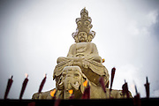 The statue of golden elephant and Buddha is seen in the temple on the top of the Buddhist Sacred Mountain on Emei Shan  (Chinese: 峨眉山市 ; pinyin: Éméishānshì) in Emei, near Chengdu, China, August 13, 2014.<br /> <br /> Confucianism, Taoism and Buddhism are the three major religions in China. Temples and statues witness their ancient roots all over the Chinese country.<br /> <br /> © Giorgio Perottino