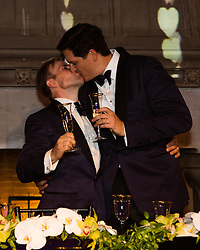 gay couple kissing on their wedding