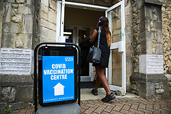 © Licensed to London News Pictures. 17/06/2021. London, UK. A woman arrives at a vaccination centre in Tottenham, north London to receive her first dose of the Pfizer Covid-19 vaccine.<br /> All over-18s in England should be able to book their Covid-19 vaccination from tomorrow. More than 60.5 million doses of coronavirus vaccine have been administered in England, according to NHS England data. Photo credit: Dinendra Haria/LNP