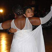 Roke Noir, rear, and Sheila Dodd, both of Oakland, California compete in the adult women's standard division of the same-sex ballroom dancing competition during the 2007 Eurogames at the Waagnatie hangar in Antwerp, Belgium on July 14, 2007. ..Over 3,000 LGBT athletes competed in 11 sports, including same-sex dance, during the 11th annual European gay sporting event. Same-sex ballroom is a growing sports that has been happening in Europe for over two decades.