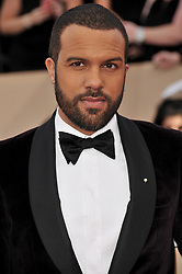 O. T. Fagbenle arrives at the 24th annual Screen Actors Guild Awards at The Shrine Exposition Center on January 21, 2018 in Los Angeles, California. <br />