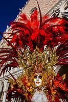 Woman in carnival costume, Bridge of Sighs, Venice Carnival (Carnevale di Venezia), Venice, Italy.