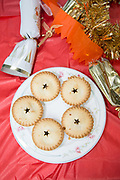 Five Christmas mince pies and festive table decorations on the 24th December 2018 in London in the United Kingdom.