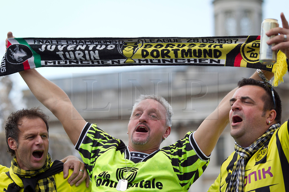 © Licensed to London News Pictures. 25/05/2013. London, UK. German Borussia Dortmund and Bayern Munich football fans are seen celebrating in Trafalgar Square, London, today (25/05/2013) as their teams prepare to meet in the first ever all German Champions League final tonight. Photo credit: Matt Cetti-Roberts/LNP