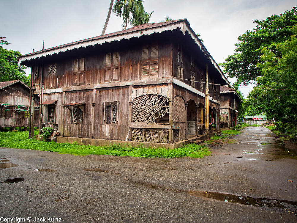 07 JUNE 2014 - YANGON, MYANMAR: A teak building in the Pegu Club. The Pegu Club in Yangon was the Officers' Club for the British Army when Myanmar was the British colony of Burma. The club, principally made of teak, is now abandoned and in decay. Squaters have moved into the parts of the complex still standing. Yangon has the highest concentration of colonial style buildings still standing in Asia. Efforts are being made to preserve the buildings but many are in poor condition and not salvageable.    PHOTO BY JACK KURTZ