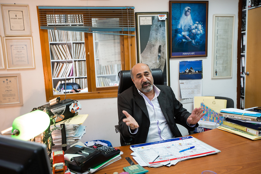Aharon Davidy, an Iranian-born Israeli is seen during an interview at his office in the Levinsky Market area in southern Tel Aviv, Israel, on April 16, 2015. The majority of the Levinsky Market vendors are traditional Iranian Jews, many of whom fled the Islamic Republic after Ayatollah Khomeini rose to power in 1979.