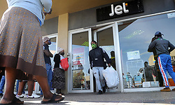 SOUTH AFRICA - Cape Town - 01 May 2020 - Man leaving Jet clothing store in Khayelitsha as South Africa has entered into the first day of level four lockdown. In late March, the country entered into lockdown in a bid to stop the spread of the coronavirus. Some restrictions will be relaxed during level four of the lockdown regulation. Picture:Brendan Magaar/African News Agency (ANA)